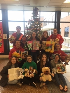 Members of the National Honor Society were spreading Christmas Cheer by collecting Christmas gifts to donate to our local Love INC.