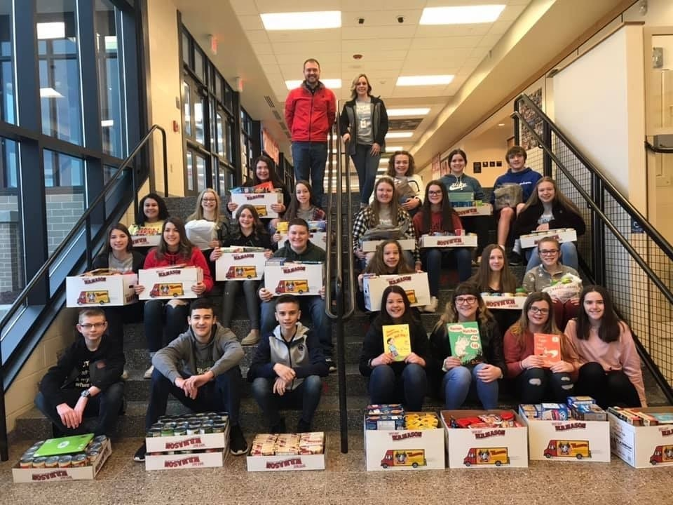 National Junior Honor Society students with the items they brought in to benefit Everett Elementary's weekend backpack program. There were over 500 donated items!